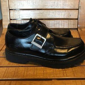 Skechers black leather shoe with lug heel